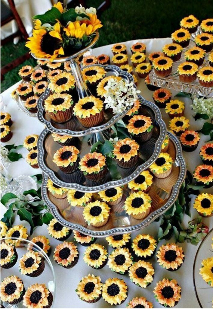 country wedding cake table with cupcakes decorated as sunflowers